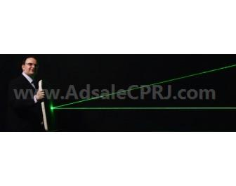 George Palikaras, founder and CEO of MTI, demonstrates how Bayfol HX photopolymer films from Covestro block and deflect the light of high power laser pointers.