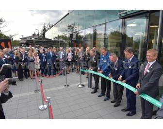 Arburg Managing Partners Michael and Eugen Hehl (2nd and 3rd from left), Subsidiary Manager Dr. Slawomir Sniady (4th from left), Managing Director Sales Gerhard Böhm (5th from left) and European Sales Director Stephan Doehler (left) inaugurates the new ATC.